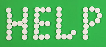 Aide de mot faite de pilules Photos libres de droits