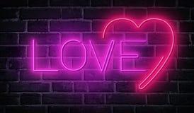 Exprimez l'amour écrit avec les lettres au néon au fond de mur de briques Photographie stock