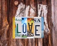 Exprimez l'amour écrit avec les plaques minéralogiques réutilisées des USA Photographie stock libre de droits