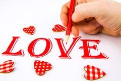 Exprimez l'amour écrit sur le livre blanc avec le crayon rouge photographie stock