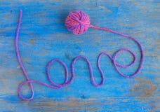 Amour de mot des laines Photographie stock