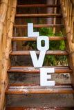 Exprimez l'amour sur la plage sablonneuse à la belle station de vacances Image libre de droits
