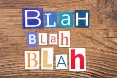 Exprimez le ` Blah - ` fade sur le fond en bois Photos libres de droits