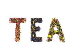 Exprimez le THÉ fait d'espèces lâches colorées de thé image libre de droits