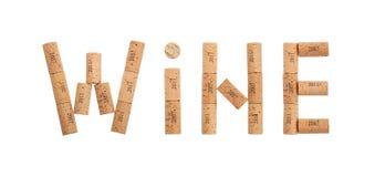 Exprimez le vin formé par des lièges d'isolement sur le blanc image libre de droits