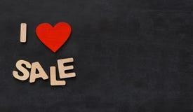 Exprimez les ventes d'amour d'I sur le fond noir avec l'espace de copie Photos stock