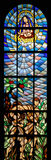 Expulsion of Adam and Eve from Paradise. Stained glass church window Royalty Free Stock Images