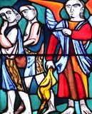 Expulsion from Paradise. Stained glass window in Basilica of St. Vitus in Ellwangen, Germany Royalty Free Stock Photos