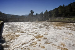 Expulsion of water after heavy rains in the embalse de Puente Nuevo Royalty Free Stock Photography