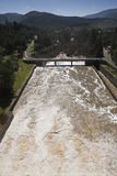 Expulsion of water after heavy rains in the embalse de Puente Nuevo to Guadiato river Royalty Free Stock Images