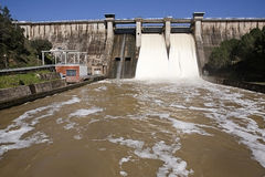 Expulsion of water after heavy rains in the reservoir of Puente Nuevo River Guadiato Royalty Free Stock Images