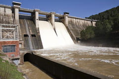 Expulsion of water after heavy rains in the reservoir of Puente Nuevo River Guadiato Stock Photos