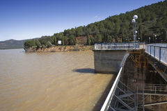 Expulsion of water after heavy rains in the reservoir of Puente Nuevo River Guadiato Royalty Free Stock Photos