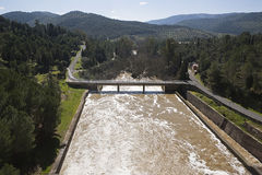 Expulsion of water after heavy rains in the reservoir of Puente Nuevo. To river Guadiato, near Cordoba, Andalusia, Spain Stock Photos