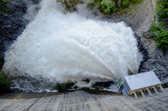 Expulsion of water. After heavy rains in the San Roque dam Stock Photos