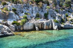 Exquisite arrangement of stones in the Greek islands. Crystal clear water and natural wonders royalty free stock image
