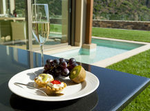 Exquisite breakfast with champagne. Exquisite breakfast with  fruits, cakes and champagne in luxury hotel Royalty Free Stock Image