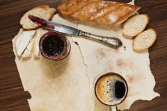 Exquisite breakfast with cheese and cranberry jam. Hipster styled breakfast of espresso coffee, baguette bread, french cheese and cranberry jam stock photo