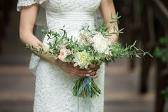 Exquisite bride with a bouquet. Exquisite bride in the boho style rustic with a bouquet Royalty Free Stock Photos