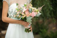 Exquisite bride with a bouquet. Exquisite bride in the boho style rustic with a bouquet Royalty Free Stock Images