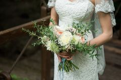 Exquisite bride with a bouquet. Exquisite bride in the boho style rustic with a bouquet Royalty Free Stock Photo