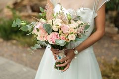 Exquisite bride with a bouquet. Exquisite bride in the boho style rustic with a bouquet Stock Images