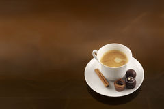 Exquisite coffee cup and chocolates Stock Photos