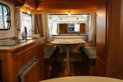 Exquisite compact interior. Of a camper stock photography