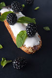 Exquisite cream dessert eclair Stock Photography