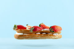 Exquisite cream dessert eclair Royalty Free Stock Image