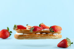 Exquisite cream dessert eclair Stock Photos