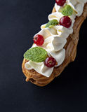 Exquisite cream dessert eclair Stock Photo