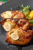 Exquisite dish from the grill. Serving grilled poultry meat served on white ceramic plate stock images
