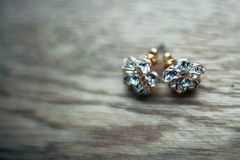 exquisite elegant expensive gold earring Royalty Free Stock Image