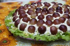 Exquisite festive salad with grapes - a beautiful dish royalty free stock photography