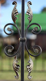 Exquisite forged bronze fence element over defocused background Stock Image