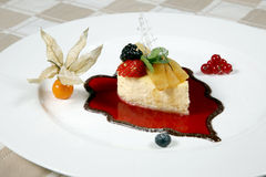 Exquisite fruit dessert in the form of a sailing boat with gold Royalty Free Stock Photos