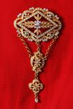 Exquisite gold brooch adorned with gems Royalty Free Stock Image