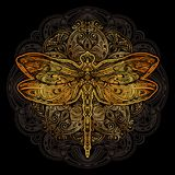 Dragonfly vector tattoo. Exquisite golden ornate stylized dragonfly against the background of the mandala. Spiritual, esoteric, totem symbol. Ethnic tribal vector illustration