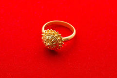 Exquisite Golden Ring on Red Background Royalty Free Stock Image
