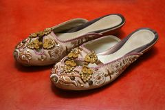 Exquisite Ladies Shoes. A pair of oriental ladies shoes with exquisite needlework of traditional Chinese style Royalty Free Stock Photos