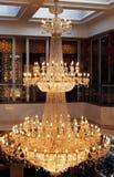 Exquisite Pendant Lamp. Exquisite golden pendant lamp in a hotel lobby stock photo