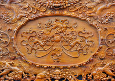 Exquisite sculpture pattern on wooden furniture. Exquisite sculpture detail of wooden furniture in Chinese traditional style, shown as featured element of art Stock Images