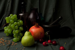 Exquisite table. Sophisticated flemish still life with pear, grapes, pomegranate, cherrys and decanter Stock Photos