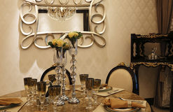 Exquisite tableware, droplight and mirror at home Stock Photo