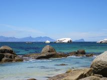 Exquisite View from Boulders Beach. View from Boulders Beach towards Cape Point in the background, exquisite scenery of Boulders and shades of blue seas. Cape stock photo