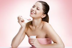 Exquisite woman with yogurt Royalty Free Stock Photo
