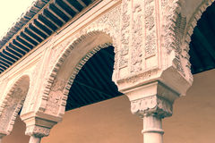 Columns with arabesques in Moorish palace of Alhambra. The exquisitely carved stone columns and arches of the Palacio los Leones. The Palacio (also Palacio del Stock Images