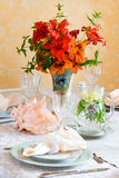 Exquisitely decorated summer time dinner table setting. Royalty Free Stock Images