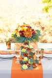Exquisitely decorated table for two. Autumn themed table setting Stock Images